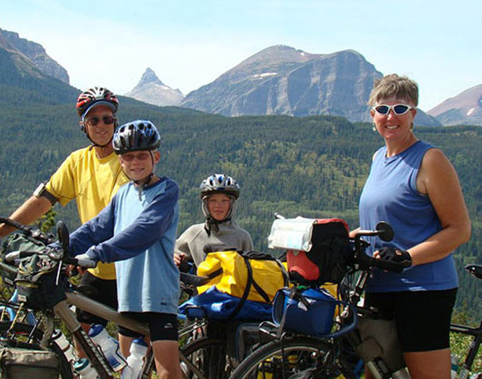 E036 Family of 4 Cycles 17,285 Miles to the End of the World – Nancy Sathre-Vogel